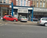 Out of Control car crashes into launderette during business hours!